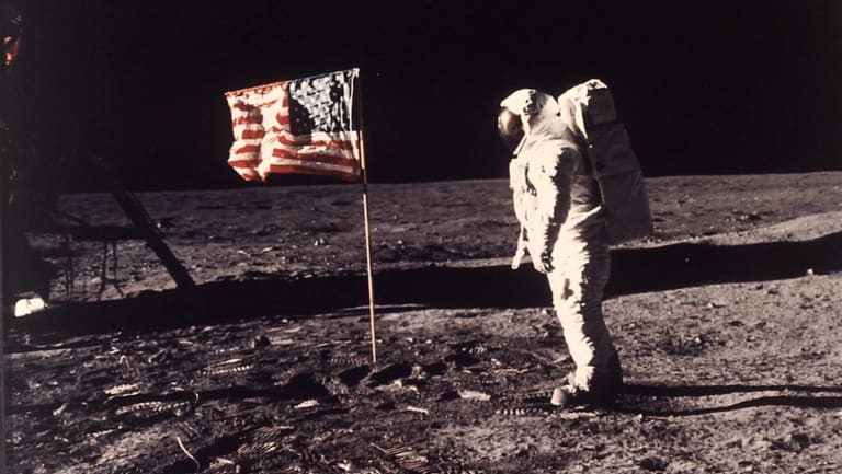 """Astronaut Edwin """"Buzz"""" Aldrin poses for a photograph beside the US flag planted on the moon during the Apollo 11 mission on July 20, 1969."""