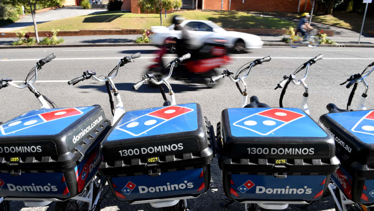 Domino's shares fell on the double downgrade.