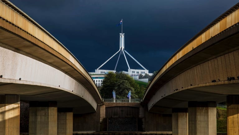 Parliament House, as seen through Commonwealth Bridge. The Barr government is considering building a bridge in between to get light rail over the lake.
