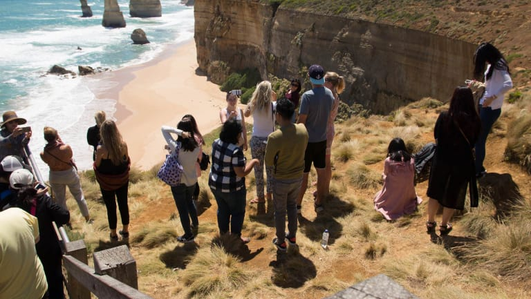 This photo, taken last Thursday, shows tourists who have jumped the barrier to take selfies at the Twelve Apostles.