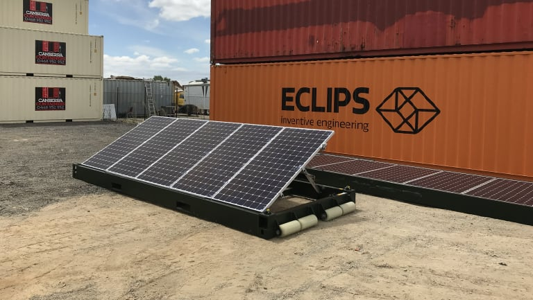 The pop-up solar units are self-contained within a shipping container.