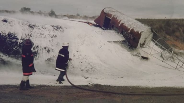 Fire fighters using toxic foam to put out a blaze during a training drill at Melbourne's Tullamarine Airport in 1998.