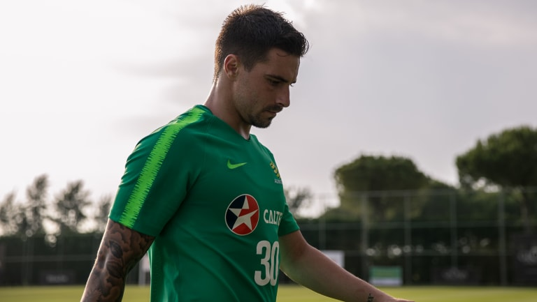 Sweating it out: Jamie Maclaren missed the cut originally, but was brought in as cover for Tomi Juric.