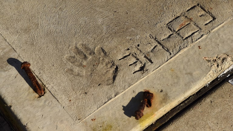 Jeff Lindsell's four-year-old hand print in the driveway of his family home in Gymea, Sydney.