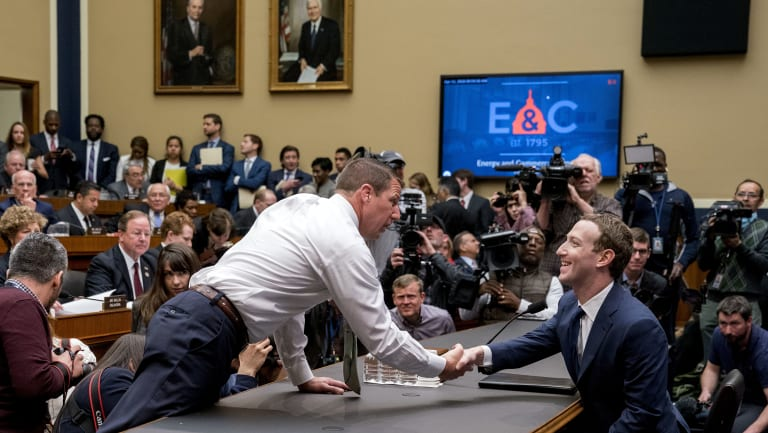 Congressman Markwayne Mullin greets Mark Zuckerberg as the Facebook founder faces a second day of questioning on Capitol Hill.