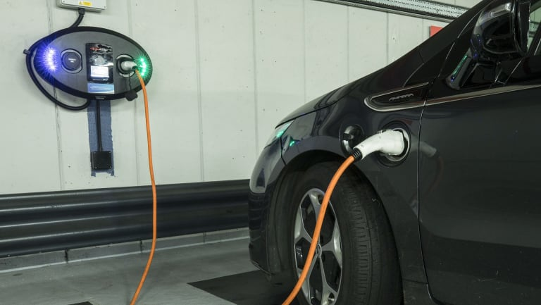 An electric vehicle on the charge in London.