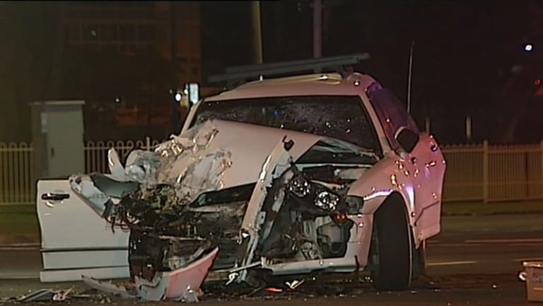 The car collided with a bus at Southport early Friday morning.