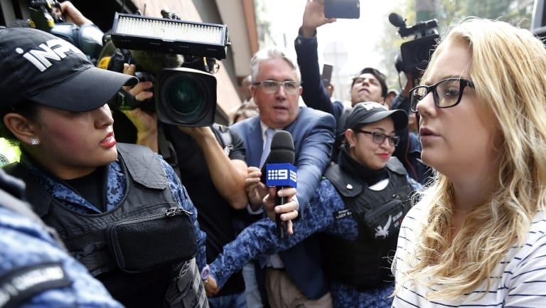 """Cassandra """"Cassie"""" Sainsbury,is escorted by police to a court hearing in Bogota, Colombia."""