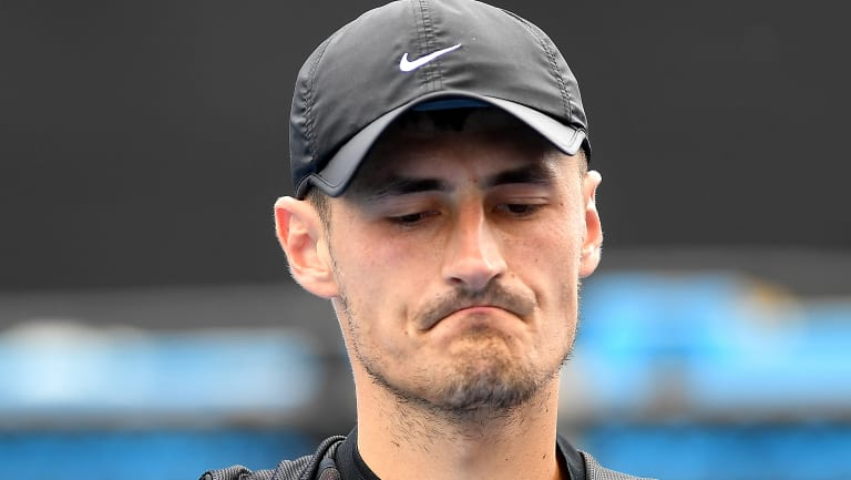 Struggling: Bernard Tomic has lost his first singles match after returning from a stint on reality TV.