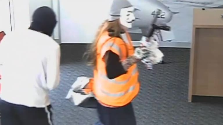 Police think the masked thief's long hair could be a wig.