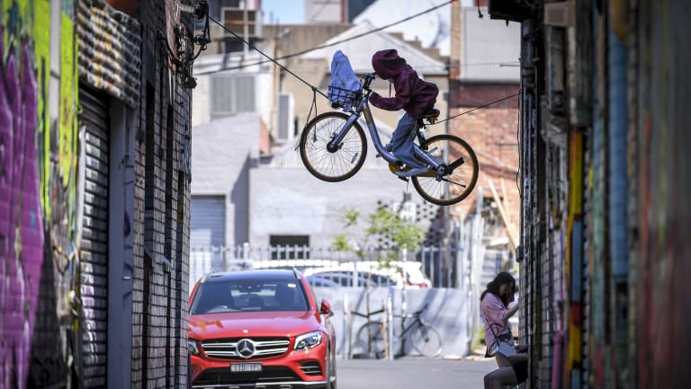 an ET-inspired sculpture made out of an oBike, suspended in Brunswick.