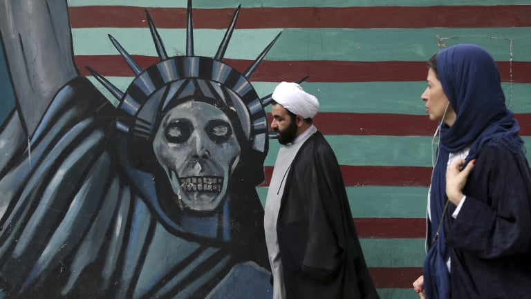 Tensions run high: An anti-US mural painted on the wall of the former American Embassy in Tehran.