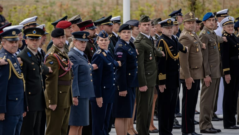 Military personnel from member states stand to attention during the NATO summit at the military and political alliance's headquarters in Brussels, Belgium.