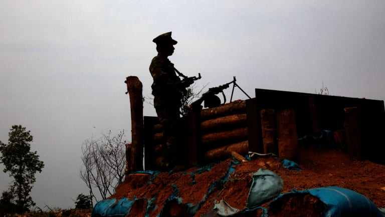 Kachin Independence Army rebel watches no man's land, towards the Myanmar army front line from a outpost in Hpalap mountain last month.