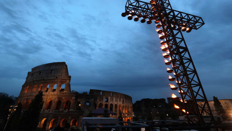 A view of the cross, lit ahead of Pope Francis arrival for the Via Crucis (Way of the Cross) torchlight procession on Good Friday. (AP Photo)