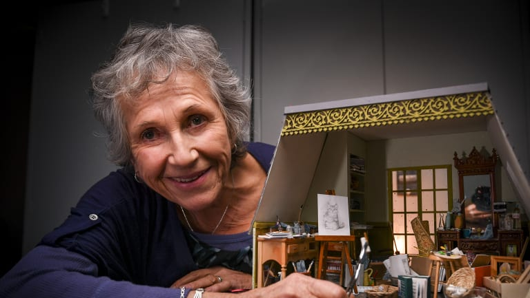Small world: miniature artist Lyn Mallett with her artist studio crammed with curious, tiny objects that she made for the Mirabel Foundation.
