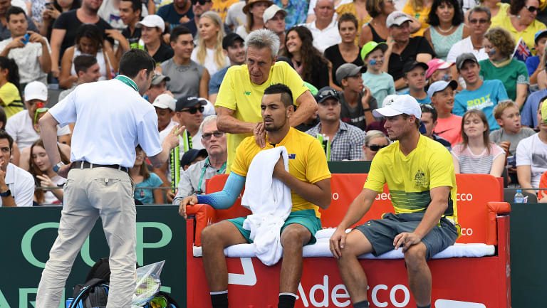 Nick Kyrgios receives treatment during a Davis Cup tie earlier this month.