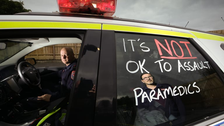 Mica Paramedic Collin Jenner (left) and Nic Santeloudi with a message of protest written on their car.