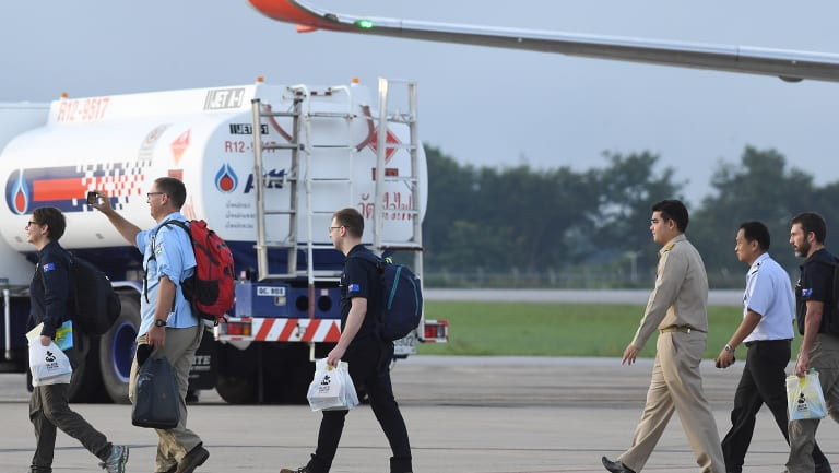 Richard Harris, second from left, and Australian support staff board an Australian RAAF plane bound for Canberra, in Chiang Rai, Northern Thailand.