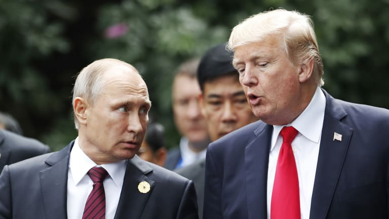 US President Donald Trump and Russia\'s President Vladimir Putin talk during the family photo session at the APEC Summit in Danang, Vietnam.