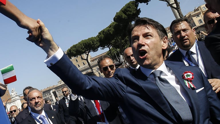 Italian Prime Minister Giuseppe Conte is greeted by citizens on during celebrations for Italy's Republic Day.