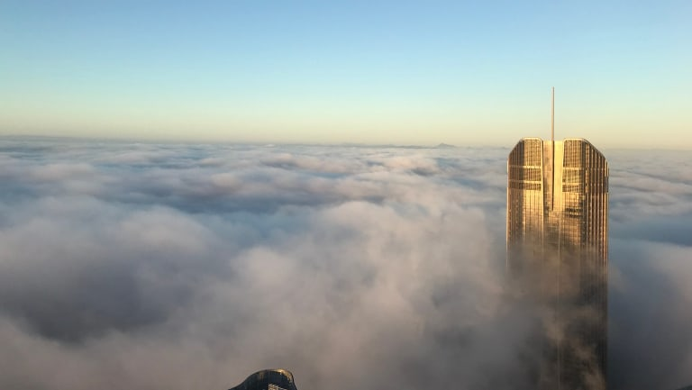 Brisbane's 1 William Street peeks above the layer of fog.