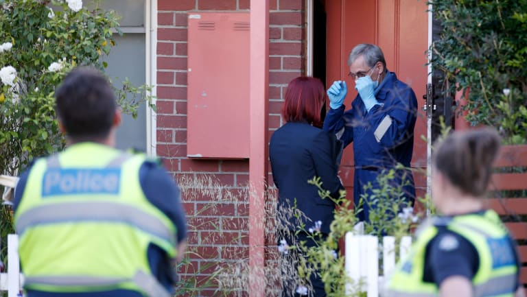Police at Sarah Gatt's Kensington unit after the discovery of her body in the bathtub.