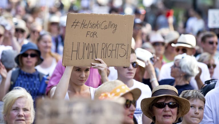 Participants seen at the crowd at #HelsinkiCalling at the march in Helsinkil on Sunday.