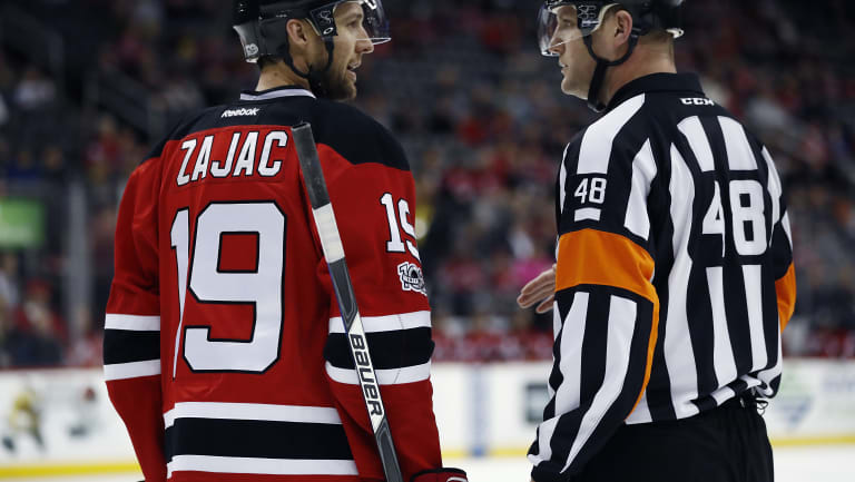 Ice cool: Three-time Canadian Amateur champion Garrett Rank officiates at an NHL game.