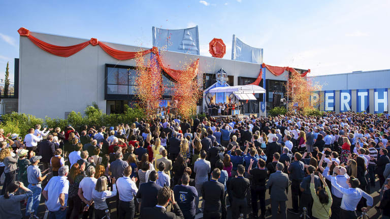 Followers celebrate the opening of Scientology's newest church in Perth on Saturday.
