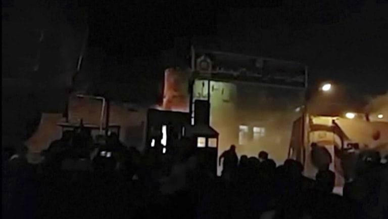 An image of attack on Iran police station in Qahdarijan, Iran, Tuesday, provided by an 'independent' news agency.
