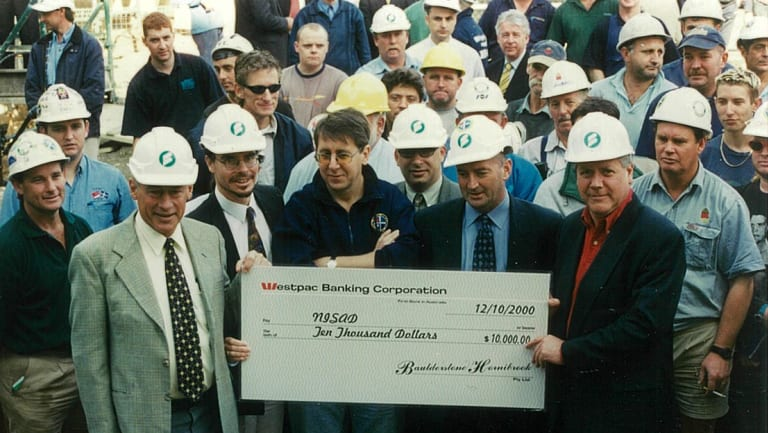 Donald McDonald, on left, raising funds and awareness of schizophrenia on a building site.