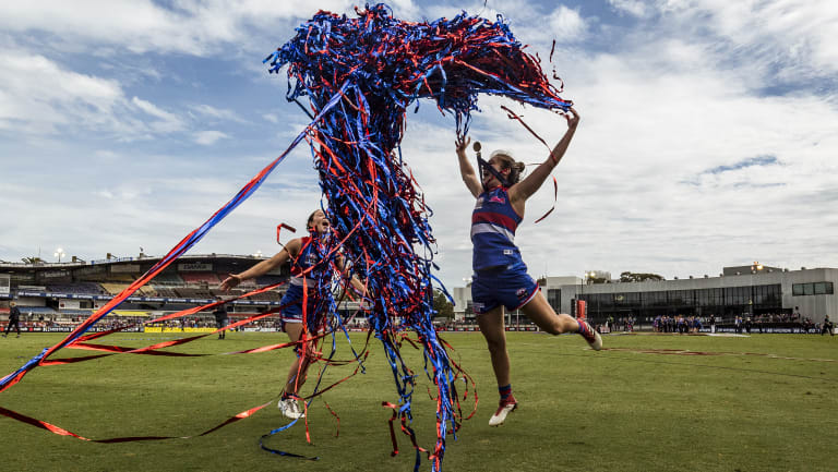 Western Bulldogs player Brooke Lochland and captain Ellie Blackburn celebrate after winning the AFLW grand final against Brisbane Lions.