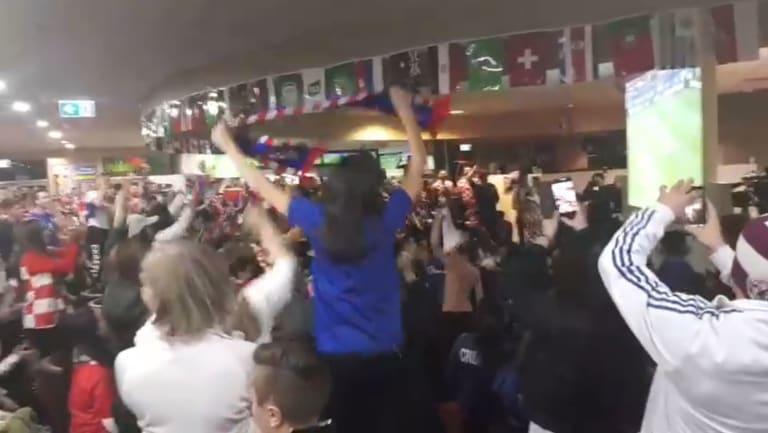 Croatian fans celebrate the semi-final win at King Tom Club.