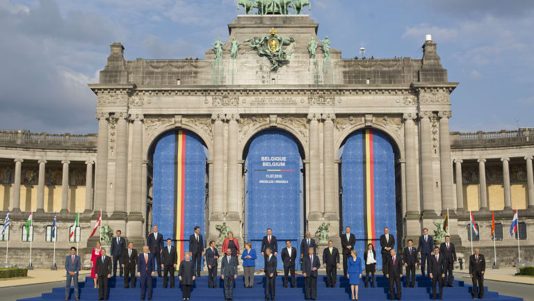 President Donald Trump on stage during a group photo of NATO heads of government at Park Cinquantenaire in Brussels, Belgium.