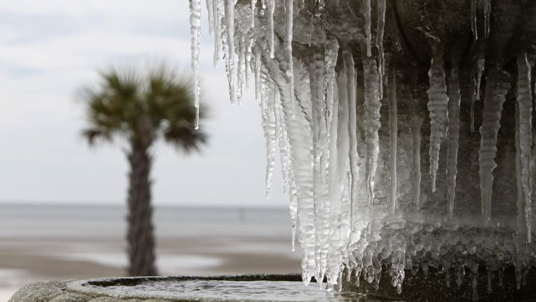Icicles hang from the fountain at Beau View condominiums in Biloxi, Mississippi.