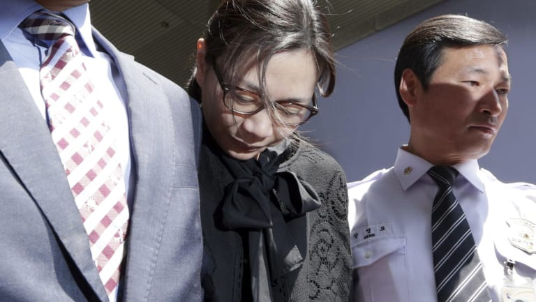 Former Korean Air executive Cho Hyun-ah, centre, leaves the Seoul High Court in 2015. The upper court sentenced Cho to 10 months in prison and then suspended the sentence for two years.