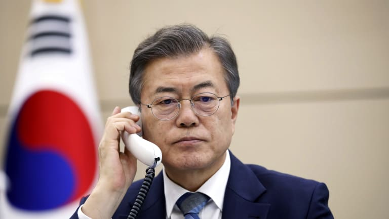 South Korean President Moon Jae-in talks on phone with Japanese Prime Minister Shinzo Abe at the presidential Blue House in Seoul.