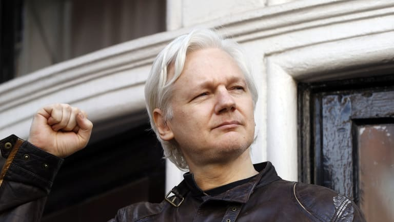"""Julian Assange greets supporters outside the Ecuadorian embassy, his """"home"""", in London in 2017."""