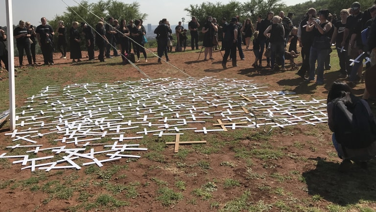 Protesters lay cross symbols on the ground during a demonstration by South African farmers and farm workers at the Voortrekker monument in Pretoria last October.