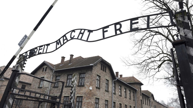 The sign Arbeit macht frei (Work makes you free) at the main gate of the former  German Nazi concentration and extermination camp Auschwitz.