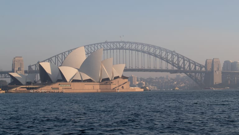 Thick smoke covers Sydney Harbour on Tuesday morning.