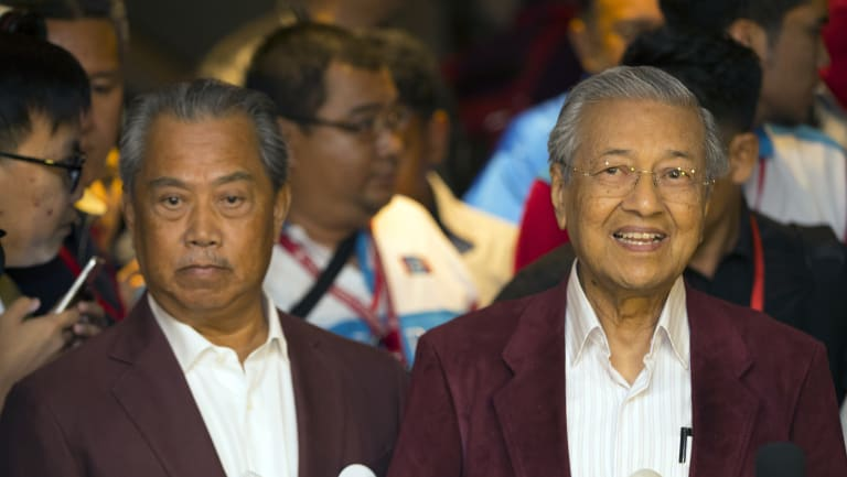Mahathir Mohamad, right, speaks to media at a hotel in Kuala Lumpur, Malaysia, Wednesday.