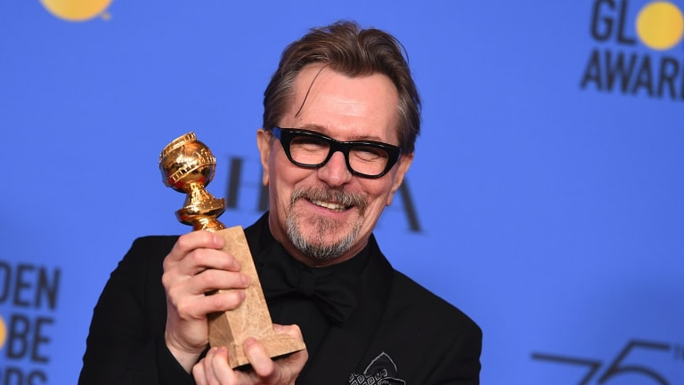 Gary Oldman poses in the press room with the award for best performance by an actor in a motion picture - drama for Darkest Hour.