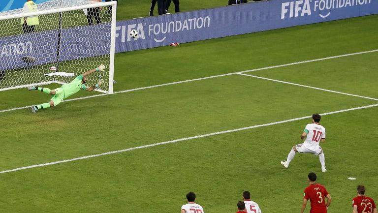 Iran's Karim Ansarifard shows Ronaldo how it's done and equalises for Iran.