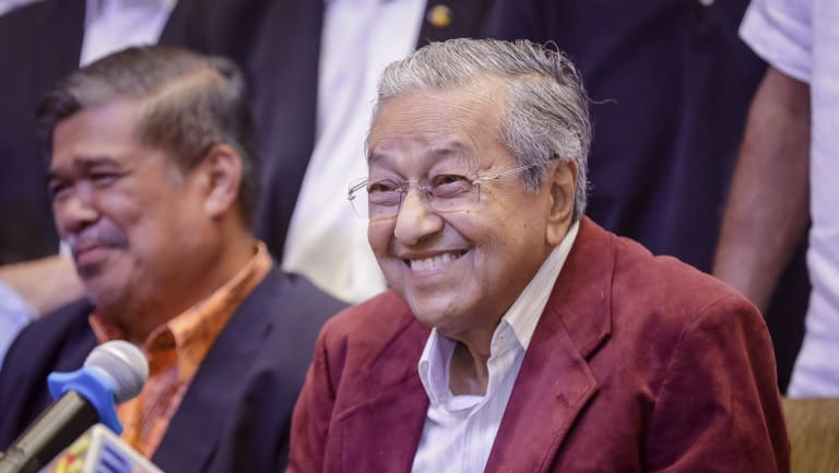Mahathir Mohamad, centre, celebrates at a hotel in Kuala Lumpur, Malaysia.