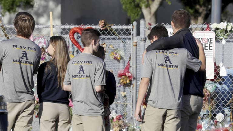 Students return to Marjory Stoneman Douglas High School after a shooting on Valentine's Day left 17 people dead.