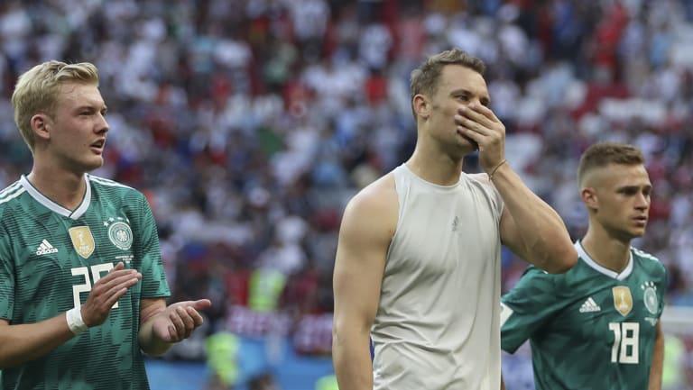 Shock loss: Germany's Julian Brandt, left, goalkeeper Manuel Neuer, and Joshua Kimmich.