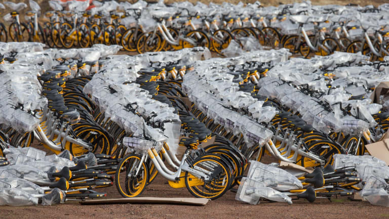 Thousands of bikes sit in an empty lot in Nunawadding. oBike launched in Melbourne in June, 2017.