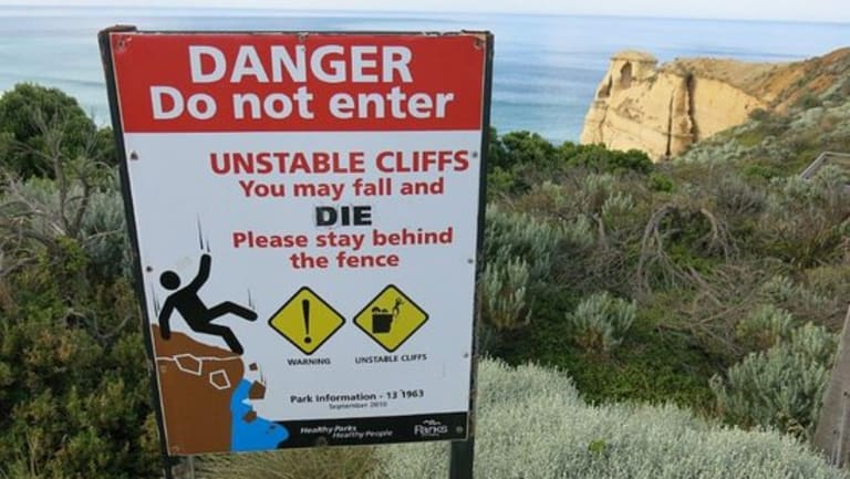A sign warning tourists of the dangers of the cliffs at the Twelve Apostles.